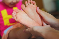 Foot. Mother was washing the feet her baby royalty free stock photos
