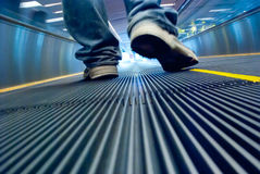 Foot move in airport corridor Royalty Free Stock Photo