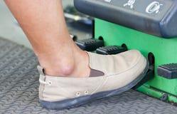 Foot On Nitrogen Tire Filling System Machine. Stock Photos