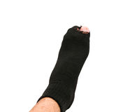 Foot in old sock and torn Royalty Free Stock Image