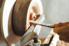 Master working on a lathe on wood acceleration. Foot operated spring pole wood lathe.Man operating a foot operated spring pole wood lathe Stock Photos