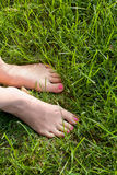 Foot over green grass Royalty Free Stock Photography