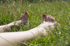 Foot over green grass. Hygiene, human, relaxation, scene, body field natural stock images