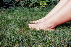 Foot over green grass side view Stock Photos