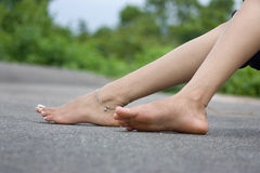 Foot over road Stock Photo
