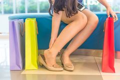 Foot pain. Caused by walking on high heels stock photos