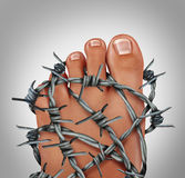 Foot Pain. Podiatry medical concept as a symbol for painful inflammation or toe injury as a group of sharp barb wire wrapped around the human feet anatomy Stock Image