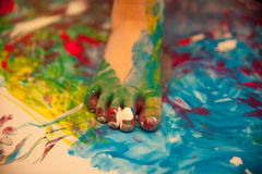 Foot painting. On a sheet on the ground Royalty Free Stock Photos
