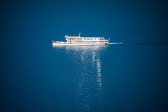 Foot passenger ferry reflective on lake surface Stock Photography