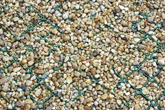 Foot Path Fragment made from Mesh and Pebbles Stock Images