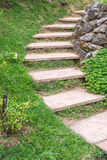 Foot path with grass in garden Stock Photo