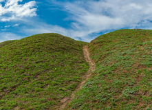 Foot-path in hilly place Royalty Free Stock Images
