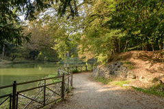 Foot path by lake in Villa Reale park, Monza, Italy Stock Photos