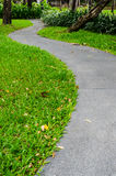 Foot path in park. Curve foot path way  in public park Royalty Free Stock Images