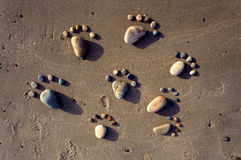 Foot, pebble, sand, art, beach Royalty Free Stock Photography