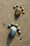 Foot, pebble, sand, art, beach Royalty Free Stock Photos