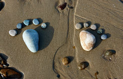 Foot, pebble, sand, art, beach Stock Images