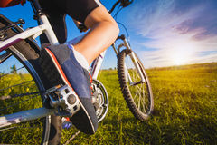 Foot on pedal of bicycle. Active summer Stock Photography