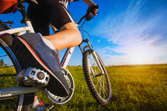 Foot on pedal of bicycle Royalty Free Stock Photography