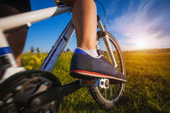 Foot on pedal of bicycle. Active summer Royalty Free Stock Image