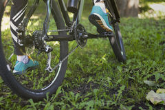 Foot on pedal of bicycle in park, active summer Stock Photo