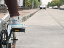 Foot on pedal of bicycle ready for departure Royalty Free Stock Photo