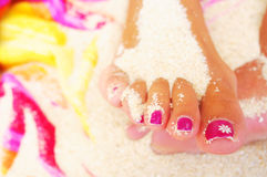 Foot and pedicure. On the beach Stock Photos