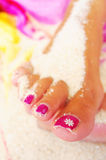 Foot and pedicure. On the beach Stock Image