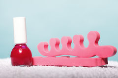 Foot pedicure red nail polish and toe separators Royalty Free Stock Photos