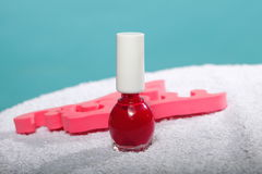 Foot pedicure red nail polish and toe separators Royalty Free Stock Photo