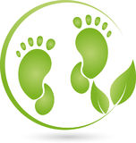 Foot and plant, leaves, foot care and orthopedics logo Royalty Free Stock Photos