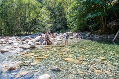 30 Foot Pool in Lynn Canyon Park, Canada. North Vancouver, Canada - Aug. 15, 2017: Visitors cooling off at the 30 Foot Pool in Lynn Canyon Park in North Royalty Free Stock Image