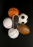 Foot print on shoe among balls in black background Royalty Free Stock Photo