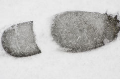 Foot print texture in fresh, soft snow.. Stock Images