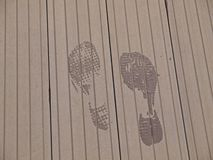 Foot Print on wood flooring Stock Image