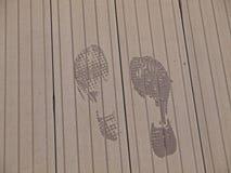 Foot Print on wood flooring. A pair of foot print on wooden flooring Stock Image