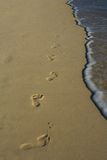 Foot prints. Foot steps in the sand Royalty Free Stock Photos