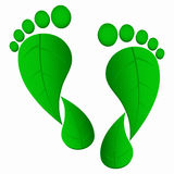 Foot prints. Green leaf foot prints on white background royalty free illustration