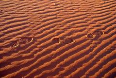 Foot prints. Through the red dunes of the namib desert in sossusvlei- namibia Stock Photo