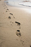 Foot prints. In the sand a long the beach at Long beach Royalty Free Stock Photo