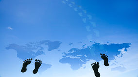Foot prints around the earth Royalty Free Stock Image