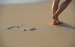 Foot Prints on Beach Stock Image