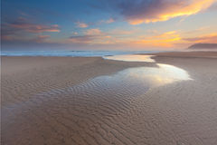 Foot prints of the ocean. Scenery at dusk on the Garden Route of South Africa Stock Photo
