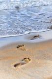 Foot prints at sand Stock Photos