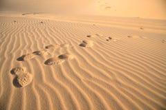 Foot prints on sand dune. Stock Photo