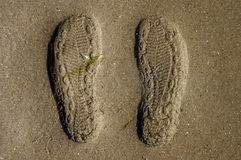 Foot prints in sand. Prints of shoe soles in the sand Stock Photo
