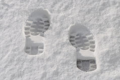 Foot prints in the snow Royalty Free Stock Photo