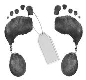 Foot prints with toe tag. Two foot prints - one with toe tag Stock Image