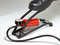 Foot Pump. A foot-operated air pump in use Stock Photo
