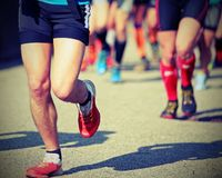 Foot race with runners committed to win Royalty Free Stock Photography